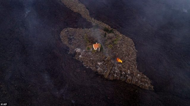 A house narrowly avoided being swallowed up by lava from La Palma's volcano as officials warned 1,000 homes are under threat from the eruption, forcing fresh evacuations on the Spanish island