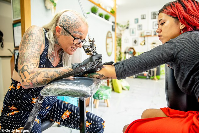 Personal services such as hairdressers and tattoo studios will be allowed to operate under a one person per four square metres, capped at five clients (pictured, stock image)
