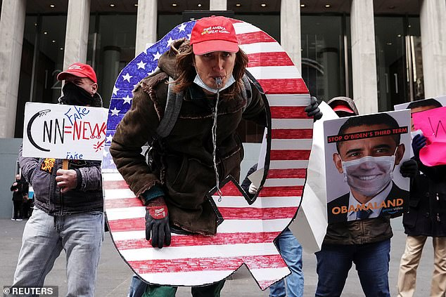 The anonymous data breach targeted Epic, a domain registrar known for hosting websites that promote far-right conspiracy theories such as QAnon.  Above, the 2020 QAnon rally in New York