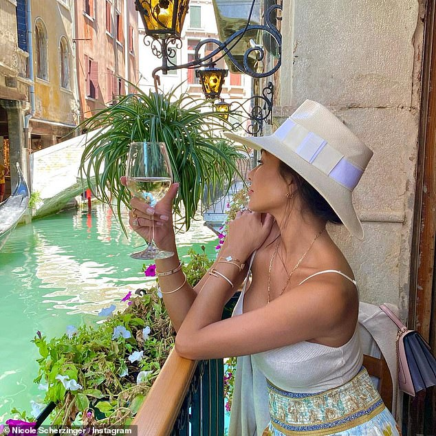 Wanderlust: In another image she looked at the blue waters and looked at ease enjoying the European sun