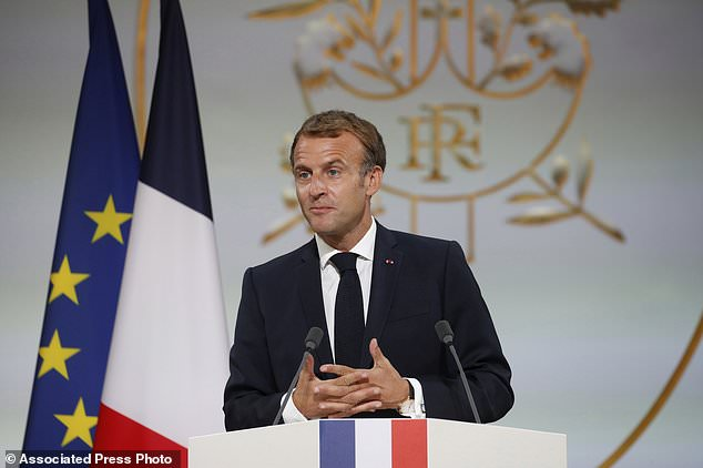 French President Emmanuel Macron delivers a speech during a meeting in memory of Algerians who fought alongside French colonial forces in the Battle of Algeria, known as the Harquis, at the Elysee Palace in Paris, Thursday, Sept. 20, 2021.  Macron's speech is the latest step in his efforts to reconcile France with its dark colonial past, particularly in Algeria.  (Pool photo via Gonzalo Fuentes/AP)