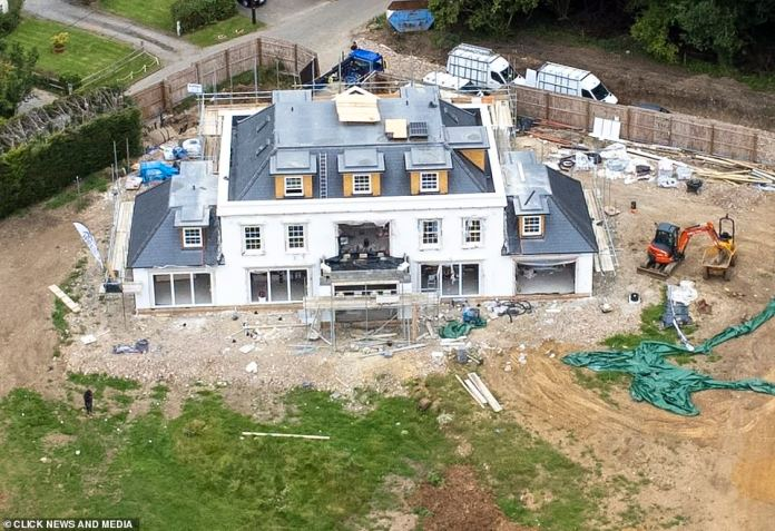Impressive: Progress is being made on the famous couple's new home in Essex as new aerial photos show the stunning exterior