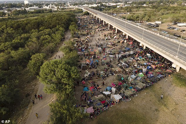 DailyMail.com has learned that tens of thousands of migrants flocked to Del Rio, Texas, because they heard the local branch of the Los Zetos cartel lets them cross the Rio Grande for free