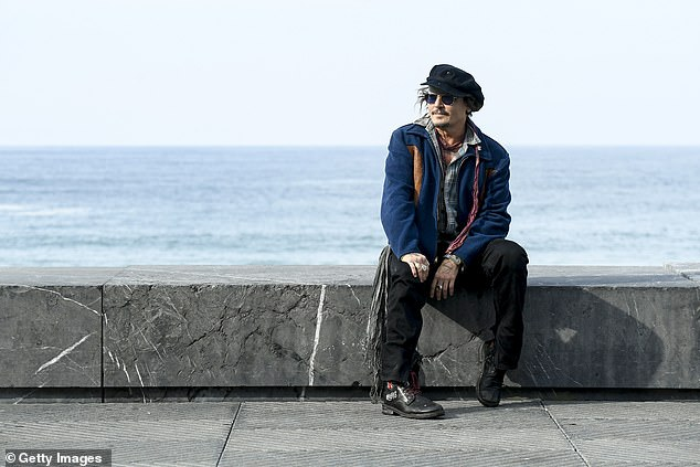 Sharing his thoughts: Ahead of taking to the stage to accept his award, Depp offered his thoughts on cancel culture, and called on people to 'stand up' for those facing 'injustice'