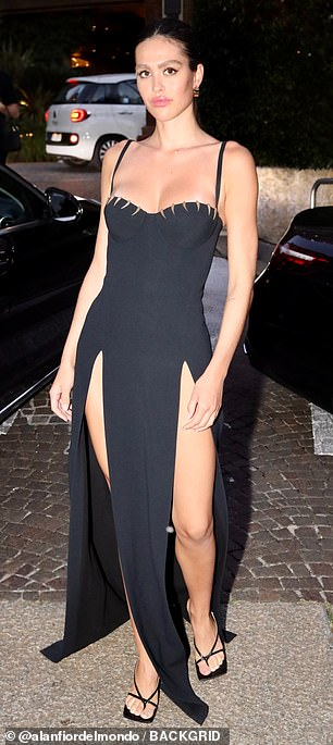 , Amelia Hamlin puts on a VERY leggy display in a slashed black evening gown, The Evepost BBC News