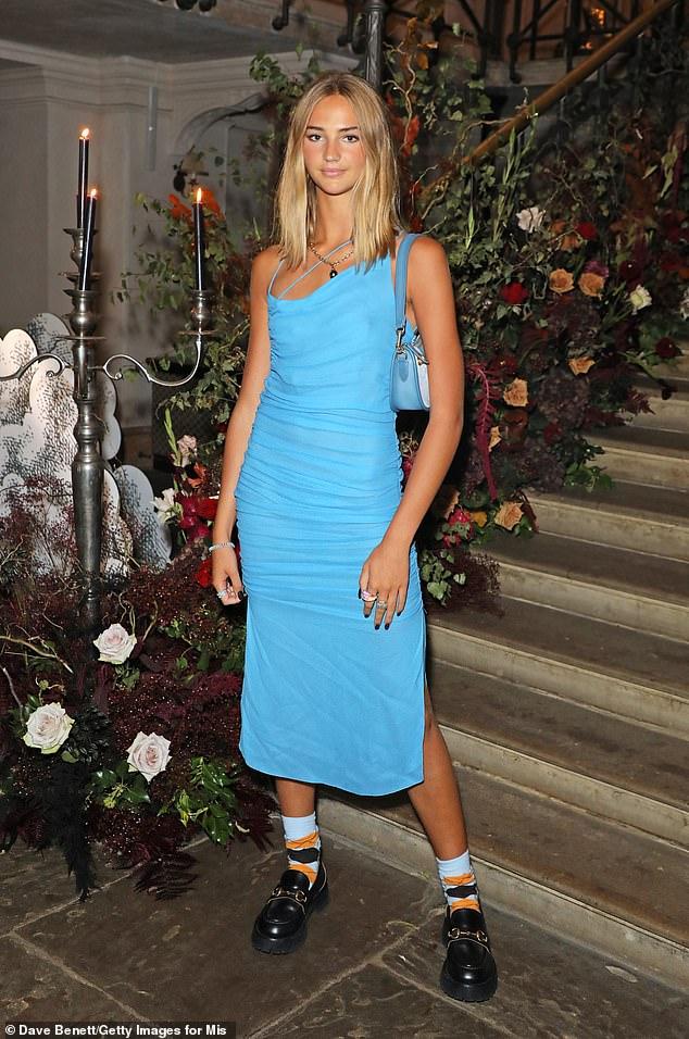 Hot Stuff: Also in attendance was Romeo Beckham's girlfriend Mia Regan, who looked sensational showing off her slim waist in a figure-hugging blue midi dress.