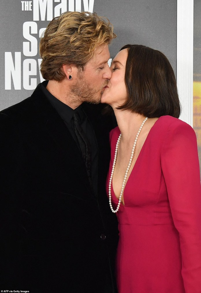 Loved up: Vera was joined by her hunky husband Renn Hawkey, who she shared kisses with on the red carpet