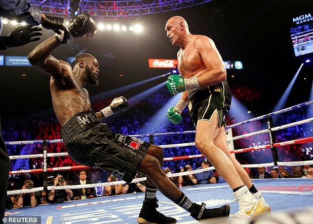 Fury (right) doesn't want to jeopardize his October 9 trilogy fight with Deontay Wilder (left)