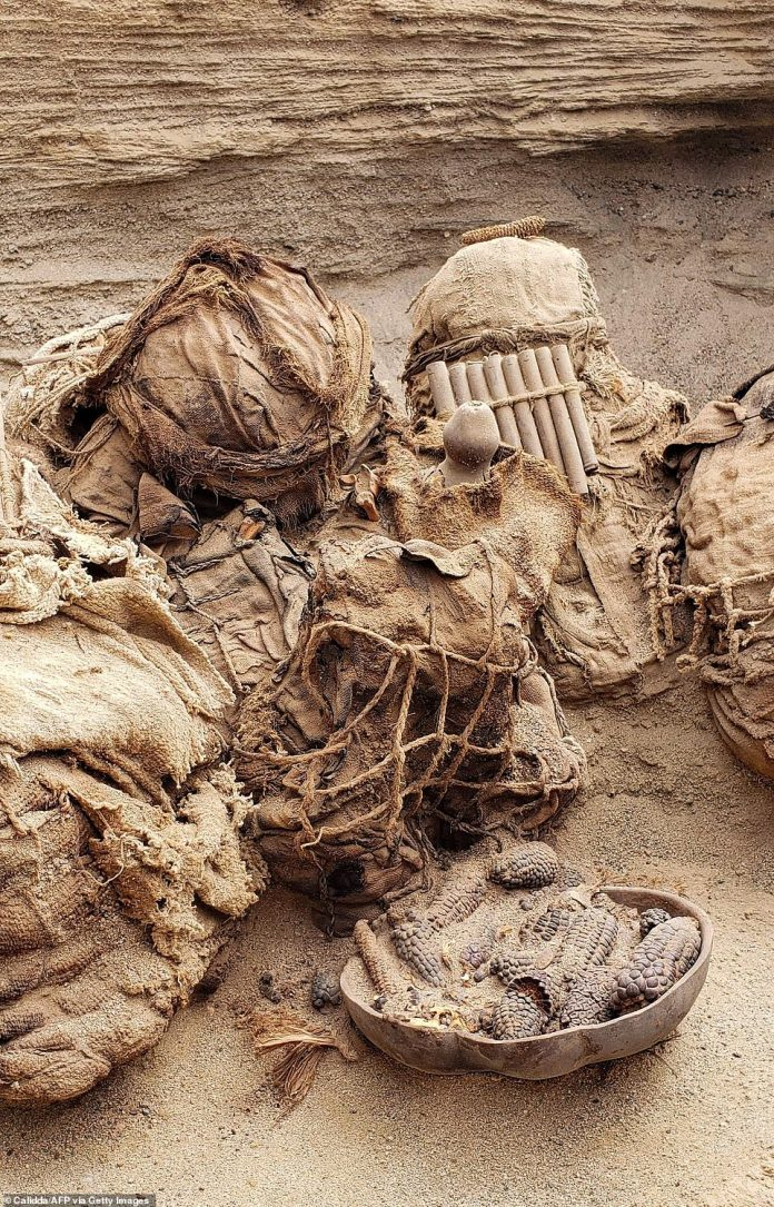 According to archaeologists, among the items found within the shared tomb were a flute and a basket of corn kernels