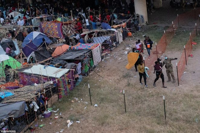 A photo from September 22 shows migrants being routed out of a makeshift border camp after being processed by US officials. The White House has pledged to deport most of the migrants back to Haiti under Title 42, but reports indicate that's not the case for some being released