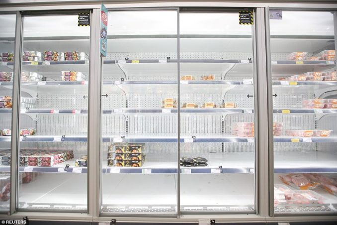 Empty shelves are seen in the meat aisle of a Co-Op supermarket branch in Harpenden