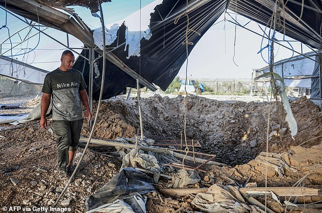 A Palestinian man inspects the damage following reported Israeli airstrikes on Rafah in the southern Gaza Strip on September 12