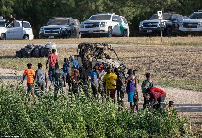 U.S. Border Patrol agents ride near a migrant camp in Del Rio, Texas on September 22