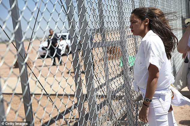 In June 2018, while running for Congress, AOC visited a Texas town where migrants were being held under the Trump administration. Images of the trip (above) showed she was visibly distraught by the scene