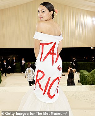Biden's tweets came afterCongresswoman Alexandra Ocasio-Cortez was slammed for attending the $35,000-a-head Met Gala donning a dress that read: 'Tax the rich'