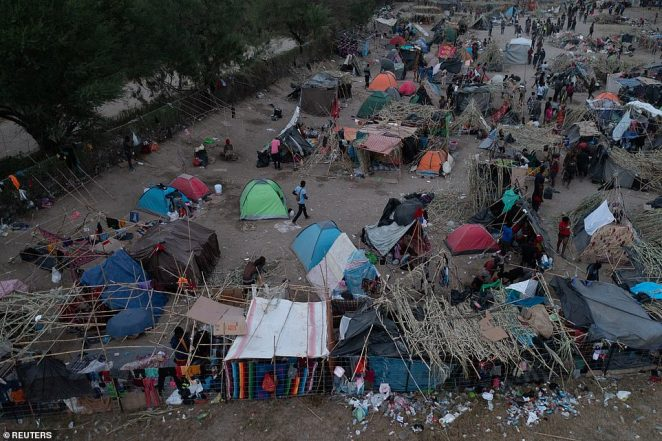 A makeshift border migrant camp is seen at daybreak along the International Bridge in Del Rio, Texas, on Wednesday