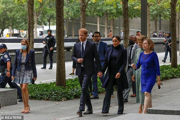 Britain's Prince Harry and Meghan, Duke and Duchess of Sussex, walk while visiting the 9/11 Memorial in Manhattan