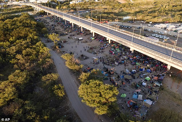 An aerial view image taken on Thursday shows thousands of mostly Haitian migrants at the encampment along the Del Rio International Bridge