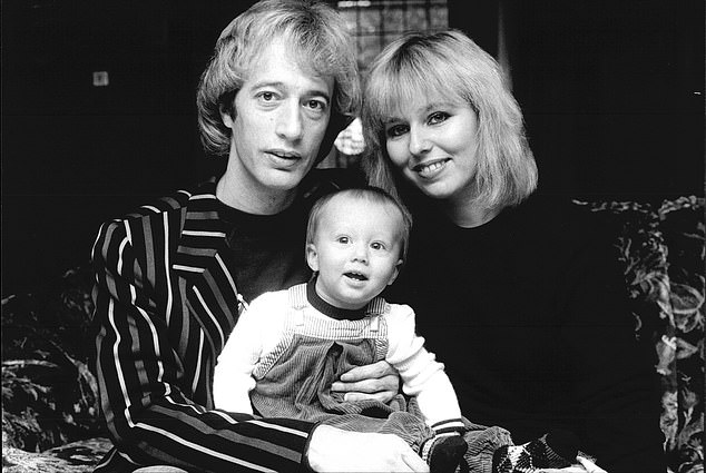 Bee Gees singer Robin Gibb with his son Robin John and girlfriend Dwina Waterford in 1983