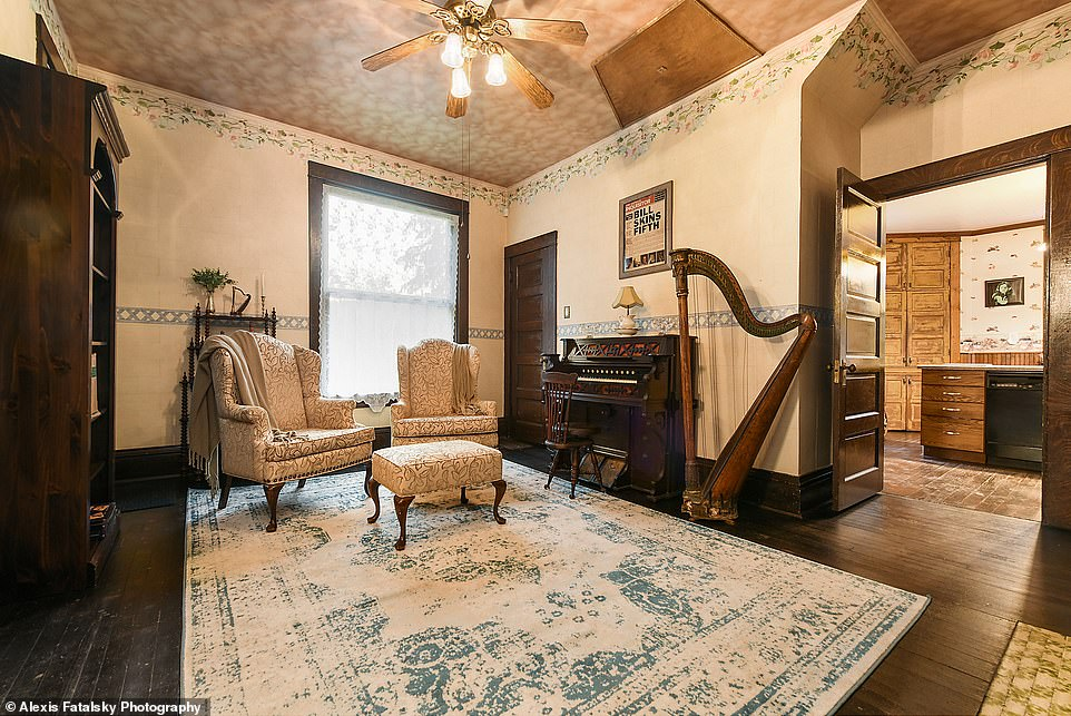 Music to your ears? Theparlor room has a decorative antique harp and church organ