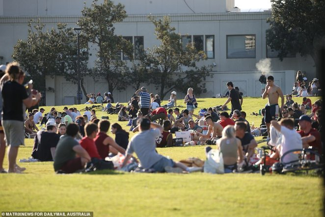 Most crowds in the St Kilda area were those exercising or picnickers (pictured) making the most of the sunny 21 degree day in Melbourne