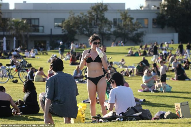 Victorian Police are set to keep up a highly visible presence around the Melbourne CBD in the coming days with rumours of more protests circling (pictured residents picnicking at St Kilda beach on Thursday)