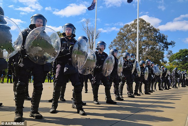 A small number of Victorian police officers have been forced into isolation after a protestor tested positive for Covid following Wednesday's large-scale protests. Pictured are officers at the protest