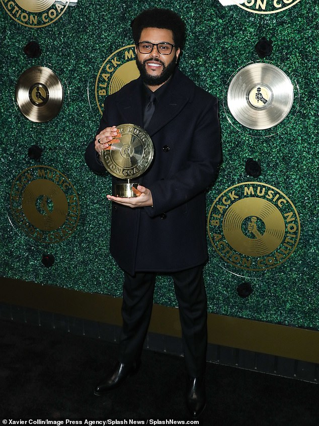 Center of Attention: The Weeknd looked as sweet as ever as he arrived at the Music In Action Awards hosted by the Black Music Action Coalition in West Hollywood on Thursday