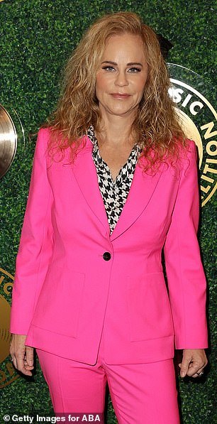 Sensational: Dina LaPolt made sure she was a must have in a candy pink blazer and matching dress pants