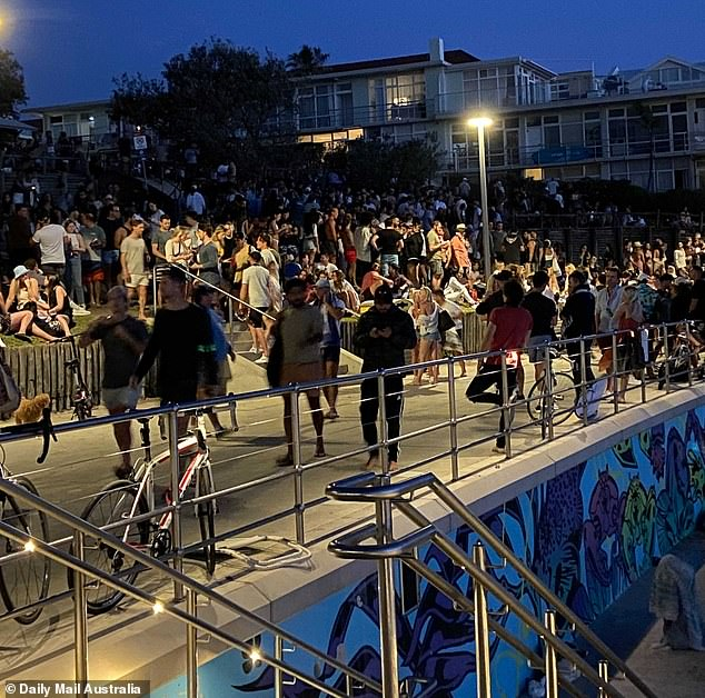 Footage taken at North Bondi in the city's eastern suburbs on Friday evening showed locals gathered in large groups on a grassy knoll