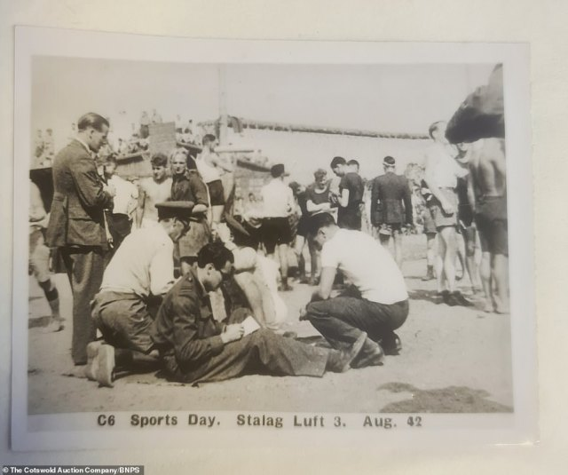 Inmates mill around during the camp's sports day in August 1942. The photos have emerged for sale nearly 80 years after they were taken