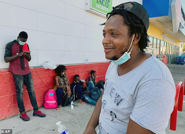 Mackenson Veillard ponders his good fortune as he waits at the Stripes gas station in Del Rio for a bus to take him and his pregnant wife to San Antonio