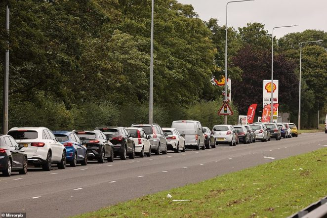 Long queues snaking down the road outside an Esso Petrol Station in Maghull, Liverpool, today