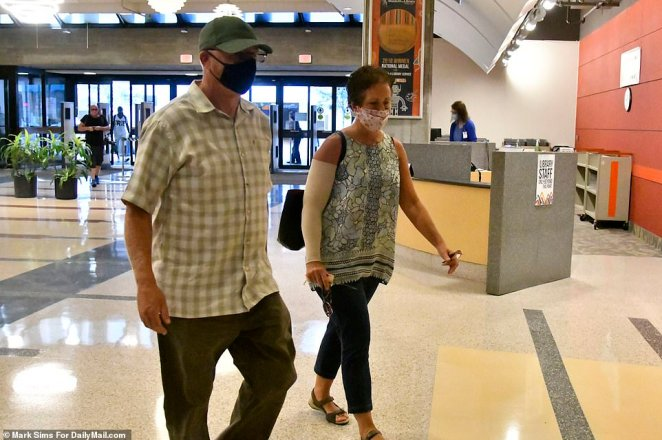 The couple were followed inside the Orlando Public Library by undercover agents who hovered in the aisles as they kept them under constant surveillance