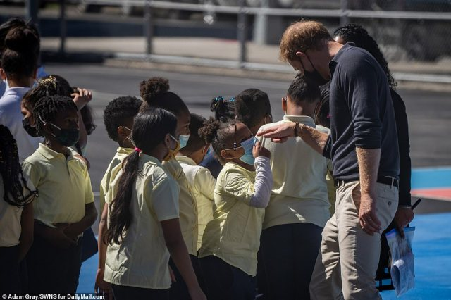 Harry jokes around with the children. Data from NYC Department of Education reveals an estimated 95 percent of students at the public school fall on the economic need index