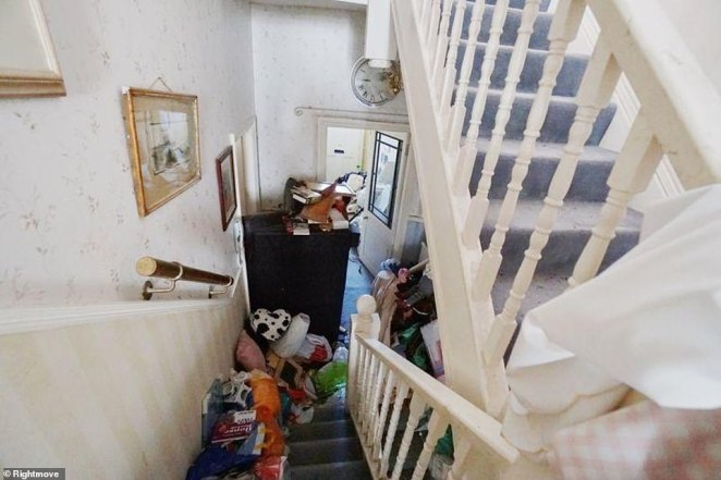 The various bits of paraphernalia create a stream of clutter that extends from the upper floors all the way down to the front door