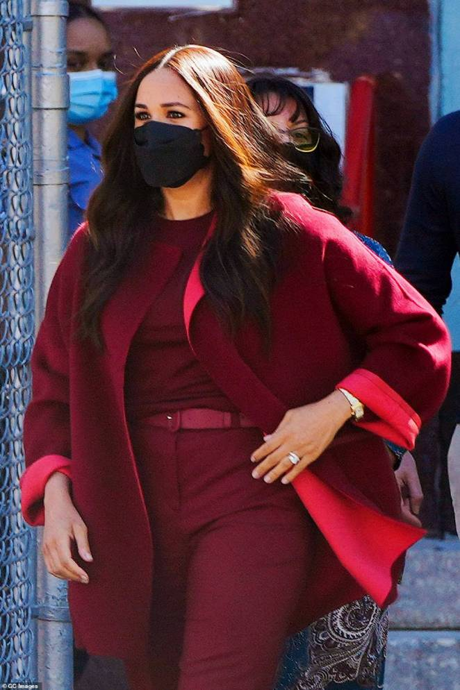 Meghan wore a $7,500 designer pant suit and around $400,000 worth of jewelry to Harlem's PS 123 Mahalia Jackson school