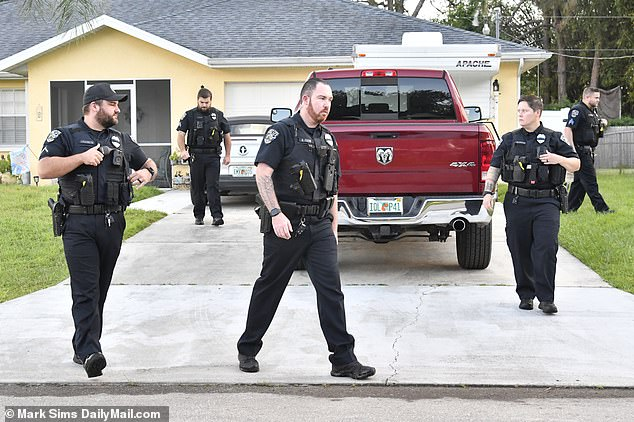 The home of missing Brian Laundrie was suddenly surrounded by cops tonight as officers probed reports of gunshots and quizzed his mother over a possible disturbance