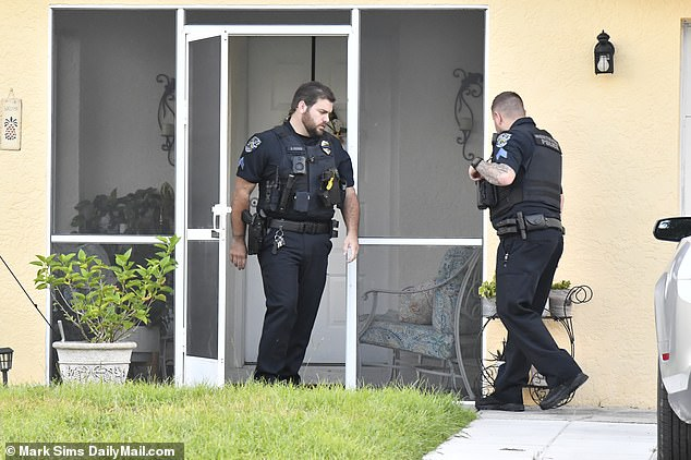 Police colleagues meanwhile knocked on the adjacent homes and asked similar questions, asking one if they had heard a 'loud bang' coming from a wooded area behind the Laundries' yard