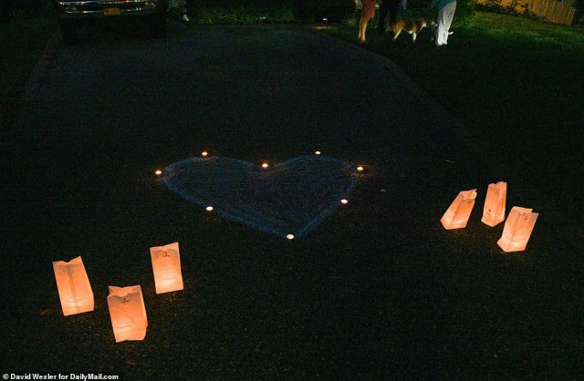 Residents put up a heart-shaped memorial. Candles were handed out and $20 donations were collected for Petito's family
