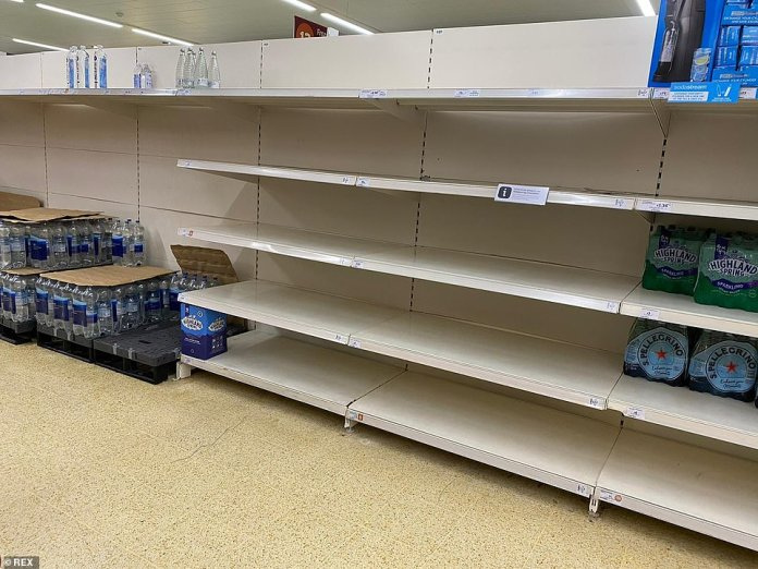 SAINSBURY'S: LONDON: Bottled water shelves in a Sainsbury's store in London were low on stock on Friday as the HGV driver crisis continues