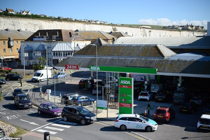 A stacked up Asda garage in Brighton as the panic buying of fuel continued to escalate on Friday