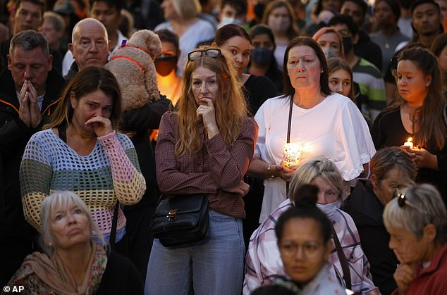 Women hold candles at a vigil for killed primary school teacher Sabina Nessa in Pegler Square, Kidbrooke, in south east London