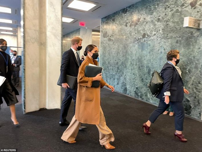 Meghan opted for a head-to-toe camel-colored outfit with a $4,214 cashmere Max Mara coat, wide-legged pants and matching shirt and stiletto court shoes