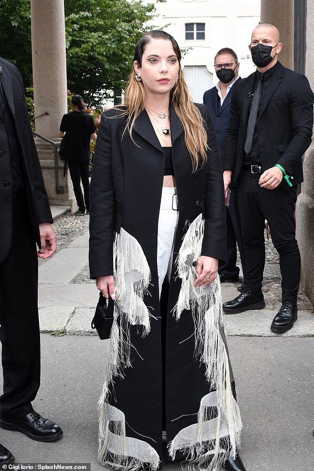 Fashionista: The actress looked sensational in a long black coat with cream fringe detailing, which she paired with a short black crop top and white trousers