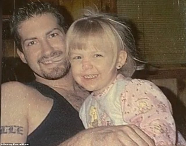 Young Gabby is seen above in the arms of her father, Joseph Petito, in this undated file photo
