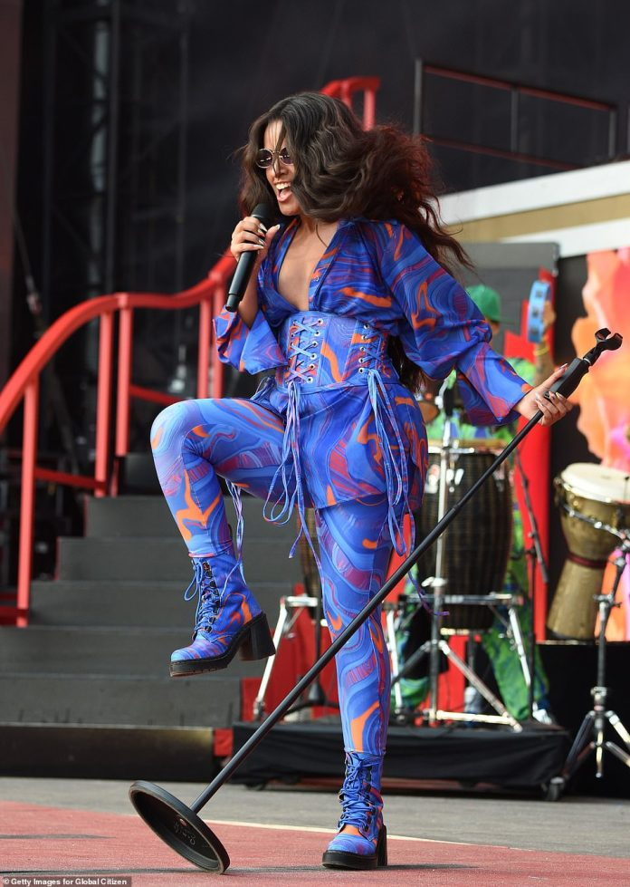 Colorful:The Havana singer had on a flowing blouse with an oil slick¿like violet pattern that was enlivened with swirls of orange and red