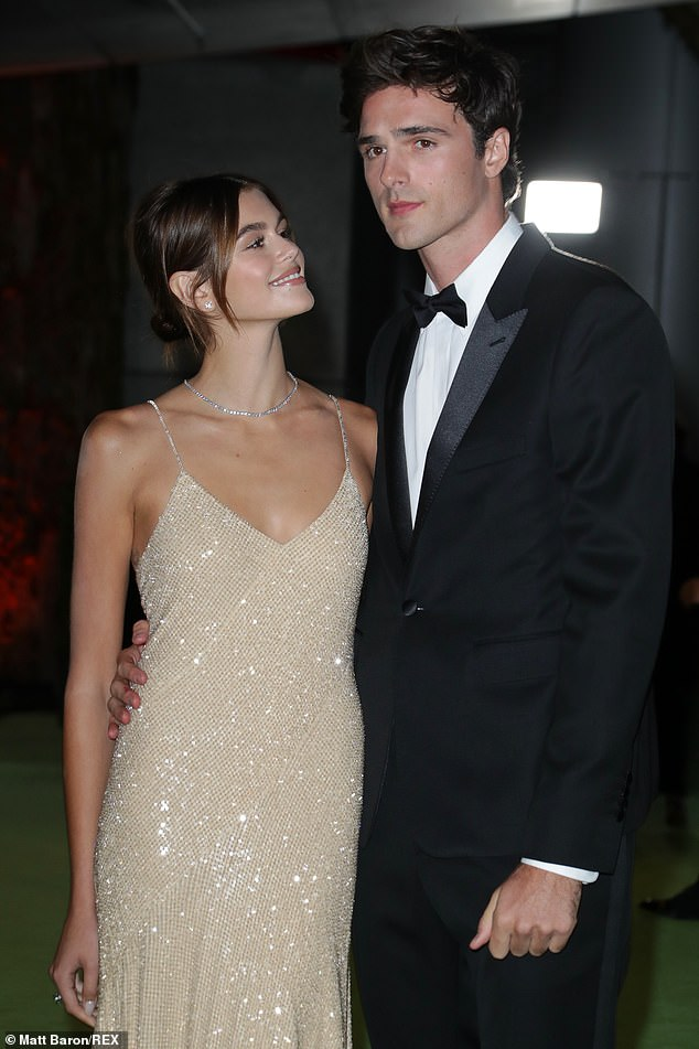Looking good! The model wore a sparkling yellow dress that shone brightly as she spent time with her boyfriend