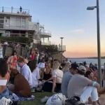 Not ONE Bondi partygoer is Covid fined after hundreds flocked to the beach for boozy picnics 💥👩💥