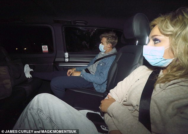 Masked up: The pair were seen on Saturday night leaving the BBC show in a taxi together, both wearing blue disposable masks